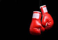 Boxing gloves over black Royalty Free Stock Photography