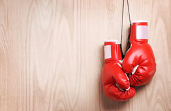 Boxing gloves over wooden background Stock Images