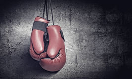 Boxing gloves. Pair of red boxing gloves hanging on wall Stock Image