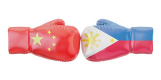 Boxing gloves with Philippines and China flags. Governments conf Royalty Free Stock Photography