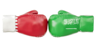 Boxing gloves with Qatar and Saudi Arabia flags. Governments con. Flict concept Royalty Free Stock Image