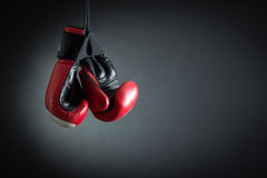 Boxing Gloves. Red boxing gloves on a dark background stock image