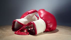 Boxing gloves rotate on table stock video footage