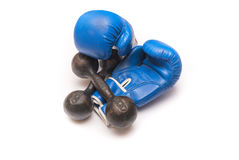 Boxing gloves and rusty dumbbell on a white background. Boxing gloves and old rusty dumbbell on a white background Royalty Free Stock Images