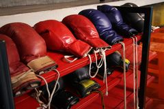 Boxing gloves on the shelf royalty free stock photo