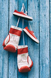 Boxing gloves and shoes hanging on the wall Stock Image