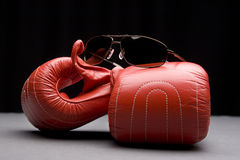 Boxing gloves and sunglasses Stock Photo