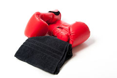 Boxing gloves and towel isolated Royalty Free Stock Images