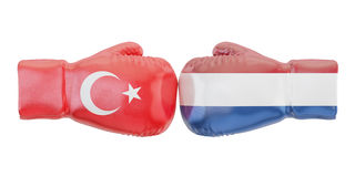 Boxing gloves with Turkey and Netherlands flags. Governments con. Flict concept Stock Images