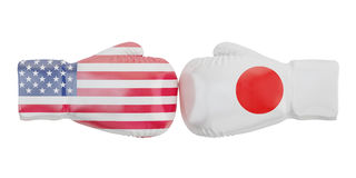 Boxing gloves with USA and Japan flags. Governments conflict con Royalty Free Stock Photo