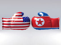 Boxing gloves with Usa and North korea flag Royalty Free Stock Photography