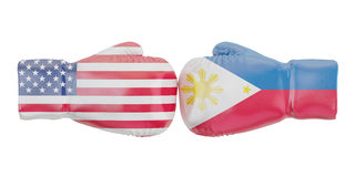 Boxing gloves with USA and Philippines flags. Governments confli. Ct concept Stock Image