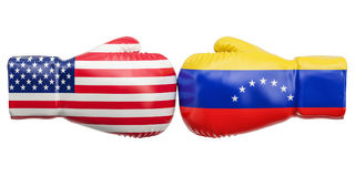 Boxing gloves with USA and Venezuela flags. Governments conflict. Concept Stock Photography