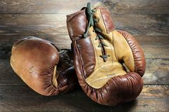 Boxing gloves. Vintage boxing gloves on wooden background royalty free stock image