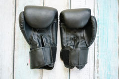 Boxing gloves. On wooden background Stock Photos