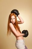 Boxing half-naked girl in the studio Stock Photo