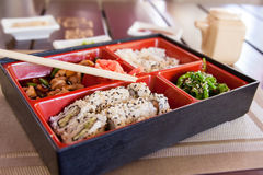 Boxing with Japanese food. Royalty Free Stock Images