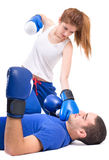 Boxing knockout. Girl knocked out man Stock Photo