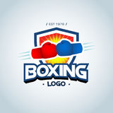 Boxing logo template. Two boxing gloves in red and blue colors.. Boxing club logotype. Boxing emblem, label, badge, t-shirt design, boxing, fight theme Stock Images