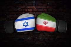 A boxing match. Confrontation between the Iran and Israel. Iranian, Israeli national flags on Boxing gloves. Sports competition between the two countries Royalty Free Stock Images