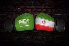 A boxing match between the two countries. A boxing match. Confrontation between the Iran and Saudi Arabia. Saudi Arabian and Iranan national flags on Boxing Stock Images