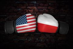 A boxing match between the USA and Russia. A boxing match. Confrontation between the Poland and USA. polish and American national flags on Boxing gloves. Sports Stock Photography