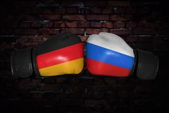 A boxing match between the two countries. A boxing match. Confrontation between the USA and Russia. Russian and American national flags on Boxing gloves. Sports Stock Image