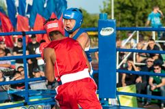 A boxing match Javier Ibanez, Cuba and Malik Bajtleuov, Russia. Defeated Javier Ibanez Royalty Free Stock Image