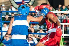 A boxing match Javier Ibanez, Cuba and Malik Bajtleuov, Russia. Defeated Javier Ibanez. ORENBURG, ORENBURG region, RUSSIA, 25 July, 2014 year. Match meeting Royalty Free Stock Image