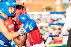 A boxing match Javier Ibanez, Cuba and Malik Bajtleuov, Russia. Defeated Javier Ibanez. ORENBURG, ORENBURG region, RUSSIA, 25 July, 2014 year. Match meeting Stock Photography