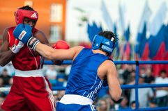 Boxing match. Orenburg, Orenburg region, Russia - 25 July 2014 year: A boxing match between the winner of the World Cup 2014 year in boxing Yordan Hernandes ( stock image