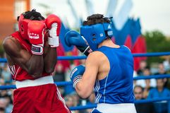 Boxing match. Orenburg, Orenburg region, Russia - 25 July 2014 year: A boxing match between the winner of the World Cup 2014 year in boxing Yordan Hernandes ( stock photo