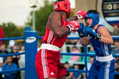 Boxing match. Orenburg, Orenburg region, Russia - 25 July 2014 year: A boxing match between the winner of the World Cup 2014 year in boxing Yordan Hernandes ( stock images