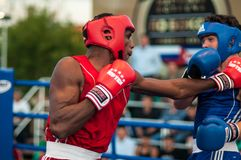 Boxing match. Orenburg, Orenburg region, Russia - 25 July 2014 year: A boxing match between the winner of the World Cup 2014 year in boxing Yordan Hernandes ( royalty free stock image