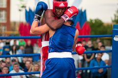 Boxing match. Orenburg, Orenburg region, Russia - 25 July 2014 year: A boxing match between the winner of the World Cup 2014 year in boxing Yordan Hernandes ( royalty free stock photo
