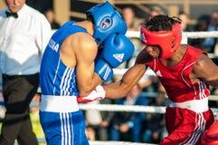 Boxing match. ORENBURG, ORENBURG region, RUSSIA, 25 July, 2014 year. Youth meeting on the boxing match between Russia and Cuba. A boxing match between Alayn stock photos