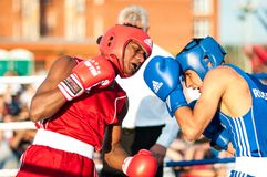 Boxing match. ORENBURG, ORENBURG region, RUSSIA, 25 July, 2014 year. Youth meeting on the boxing match between Russia and Cuba. A boxing match between Alayn stock photography