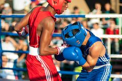 Boxing match. ORENBURG, ORENBURG region, RUSSIA, 25 July, 2014 year. Youth meeting on the boxing match between Russia and Cuba. A boxing match between Alayn royalty free stock photography