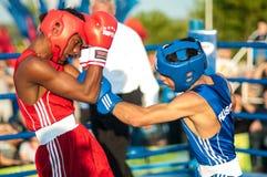 Boxing match. ORENBURG, ORENBURG region, RUSSIA, 25 July, 2014 year. Youth meeting on the boxing match between Russia and Cuba. A boxing match between Alayn royalty free stock photo