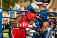 Boxing match. ORENBURG, ORENBURG region, RUSSIA, 25 July, 2014 year. Youth meeting on the boxing match between Russia and Cuba. A boxing match between Alayn stock image