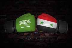A boxing match between the two countries. A boxing match. Confrontation between the Syria and Saudi Arabia. Saudi Arabian and Syrian national flags on Boxing Stock Image