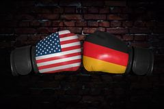 A boxing match between the USA and Germany. A boxing match. Confrontation between the USA and Germany. German and American national flags on Boxing gloves Stock Photos