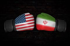 A boxing match between the USA and Iran. A boxing match. Confrontation between the USA and Iran. Iranian and American national flags on Boxing gloves. Sports Stock Image