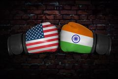 A boxing match between the USA and Russia. A boxing match. Confrontation between the India and USA. Indian and American national flags on Boxing gloves. Sports Royalty Free Stock Images