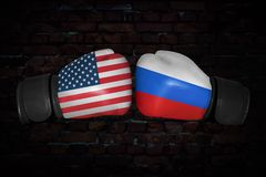 A boxing match between the USA and Russia. A boxing match. Confrontation between the USA and Russia. Russian and American national flags on Boxing gloves. Sports Royalty Free Stock Image