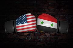 A boxing match between the USA and Syria. A boxing match. Confrontation between the USA and Syria. Syrian and American national flags on Boxing gloves. Sports Stock Photos