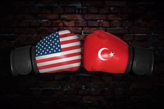A boxing match between the USA and Turkey. A boxing match. Confrontation between the USA and Turkey. Turkish and American national flags on Boxing gloves. Sports Royalty Free Stock Images