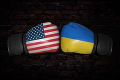 A boxing match between the USA and Ukraine. A boxing match. Confrontation between the USA and Ukraine . Ukrainian and American national flags on Boxing gloves Royalty Free Stock Photos