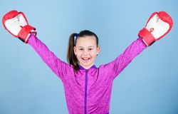 Boxing provide strict discipline. Girl cute boxer on blue background. Contrary to stereotype. Boxer child in boxing. Gloves. Confident teen. Enjoyment from royalty free stock images