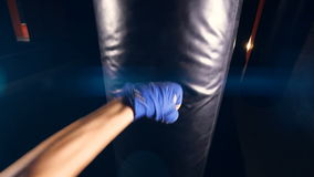 Boxing of the punching bag by unrecognised person. Close-up. 4K. Boxing of the punching bag by unrecognised person. Close-up stock footage